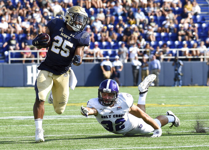 Navy slotback Tazh Maloy runs for big yards in the second quarter of an NCAA college football game against Holy Cross, Saturday, Aug. 31, 2019, in Annapolis, Md. (Paul W. Gillespie/Capital Gazette via AP)