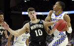 Wofford's Nathan Hoover (10) guards Kentucky's Keldon Johnson, right, as he looks to pass during the first half of a second-round game in the NCAA men's college basketball tournament in Jacksonville, Fla., Saturday, March 23, 2019. (AP Photo/John Raoux)