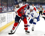 Columbus Blue Jackets forward Oliver Bjorkstrand, left, controls the puck in front of Tampa Bay Lightning forward Barclay Goodrow during the second period of an NHL hockey game in Columbus, Ohio, Tuesday, April 6, 2021. (AP Photo/Paul Vernon)