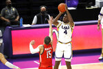 LSU forward Darius Days (4) shoots over Texas Tech guard Kevin McCullar (15) in the second half of an NCAA college basketball game in Baton Rouge, La., Saturday, Jan. 30, 2021. Texas Tech won 76-71. (AP Photo/Tyler Kaufman)