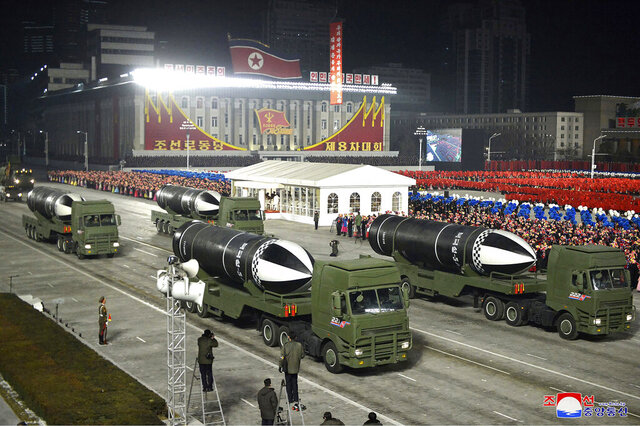 FILE - This Jan. 14, 2021, file photo provided by the North Korean government shows missiles during a military parade marking the ruling party congress, at Kim Il Sung Square in Pyongyang, North Korea. Last year was a disaster for North Korean leader Kim Jong Un, who helplessly watched his country's economy decay amid pandemic border closures while brooding over the collapse of made-for-TV summits with former President Donald Trump that failed to lift sanctions from his country. Now he must start over with President Joe Biden, who has previously called him a thug and accused Trump of chasing spectacles instead of meaningful reductions of Kim's nuclear arsenal.  Korean language watermark on image as provided by source reads: