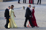 President Donald Trump, British Prime Minister Theresa May, front and first lady Melania Trump, and May's husband Philip May, arrive at Blenheim Palace, in Blenheim west of London, England, Thursday, July 12, 2018. (Will Oliver/Pool Photo via AP)