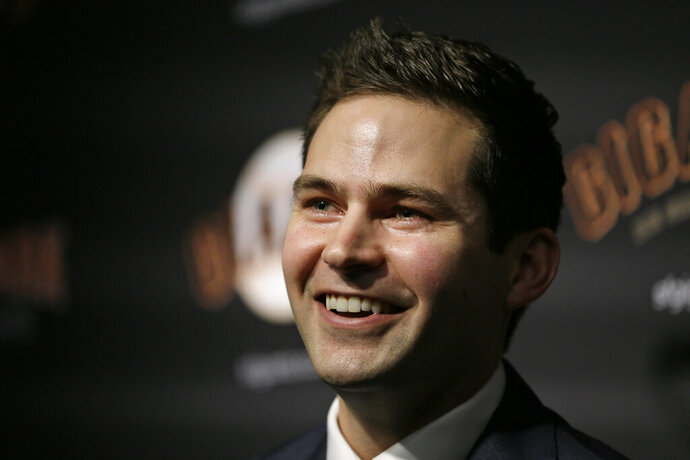 San Francisco Giants general manager Scott Harris smiles during a news conference after his introduction at Oracle Park Monday, Nov. 11, 2019, in San Francisco. The Giants hired Harris from the Chicago Cubs to become general manager, filling a void of more than a year after the club had gone without a GM during president of baseball operations Farhan Zaidi's first season in the position. (AP Photo/Eric Risberg)