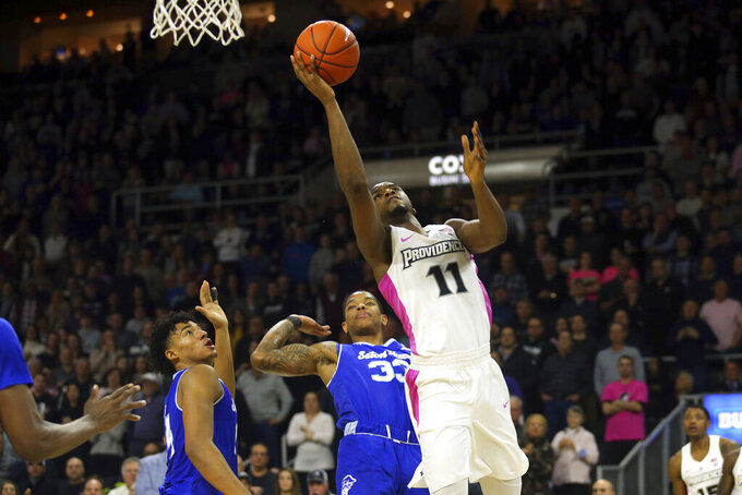 Providence's Alpha Diallo (11) makes a basket during the second half of an NCAA college basketball game against Seton Hall, Saturday, Feb. 15, 2020, in Providence, R.I. (AP Photo/Stew Milne)