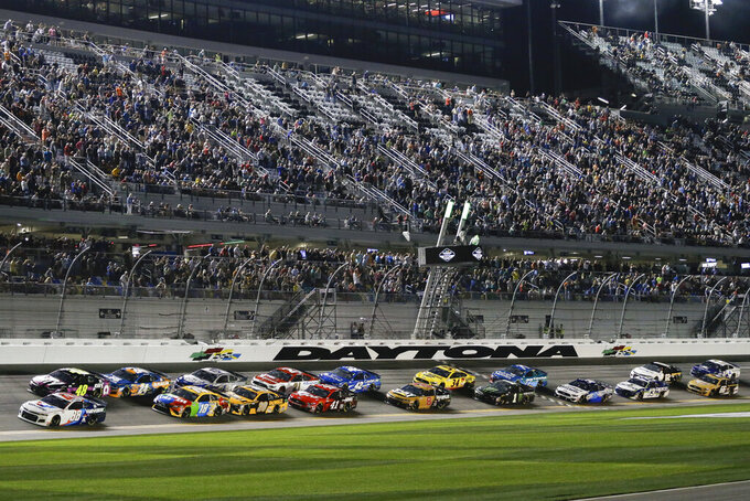 Alex Bowman (88) and Jimmie Johnson (48) lead the field to start the second of two NASCAR Daytona 500 qualifying auto races at Daytona International Speedway, Thursday, Feb. 13, 2020, in Daytona Beach, Fla. (AP Photo/Terry Renna)