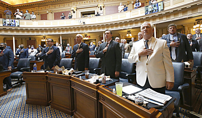 House of Delegates members recite the Pledge of Allegiance to begin the session inside the Virginia State Capitol in Richmond, Va., Monday, Aug. 2, 2021, the first day of the General Assembly Special Session. (Bob Brown/Richmond Times-Dispatch via AP)