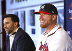 Atlanta Braves Executive Vice President and General Manager Alex Anthopoulos, left, introduces left-handed pitcher Will Smith during a press conference at SunTrust Park in Atlanta, Tuesday, Nov. 19, 2019. (Curtis Compton/Atlanta Journal-Constitution via AP)