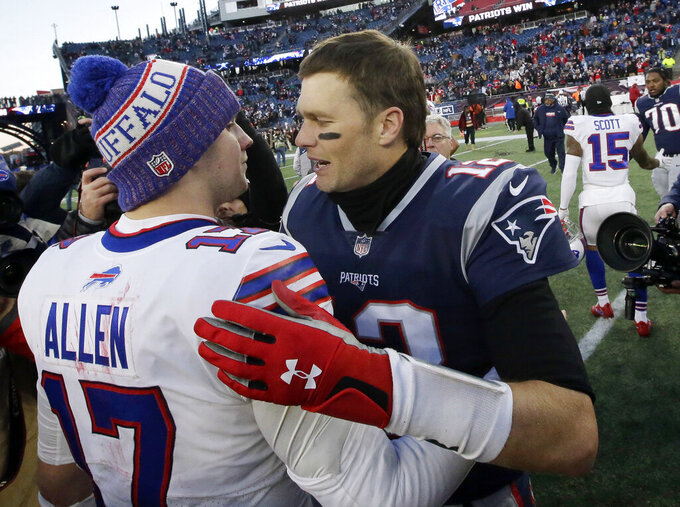 FILE - In this Dec. 23, 2018, file photo, Buffalo Bills quarterback Josh Allen, left, and New England Patriots quarterback Tom Brady speak at midfield after an NFL football game in Foxborough, Mass. The Buffalo Bills brace for Tom Brady and the Patriots to make their annual visit to town in what's been an AFC East rivalry heavily weighted in New England's favor for the past 20 years. The new-look Bills hope this weekend might be different in a matchup of two 3-0 teams.(AP Photo/Steven Senne, File)