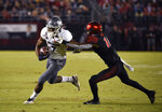 Nevada wide receiver Romeo Doubs (7) tries to break the tackle of San Diego State cornerback Luq Barcoo (16) during the first half of a college football game Saturday, Nov. 9, 2019, in San Diego. U.S. (AP Photo/Denis Poroy)