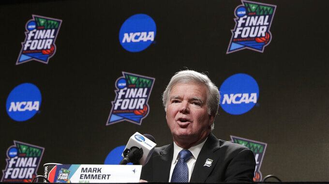 "FILE - In this April 4, 2019, file photo, NCAA President Mark Emmert answers questions at a news conference at the Final Four college basketball tournament in Minneapolis. College athletes are continuing to function at high levels in the classroom but their Academic Progress Rate scores appear to be hitting a peak. The most recent statistics, released Wednesday, May 8, 2019, show this year's overall four-year score matched last year's record-high of 983 and that the four-year scores in football, men's basketball and women's basketball also matched last year's marks. Baseball improved by one point to 976 while single-year scores at Historically Black Colleges declined slightly. ""We are seeing some flattening of rates, which is not unusual given the large amount of data over a long period of time,"" Emmert said in a statement. (AP Photo/Matt York, File)"