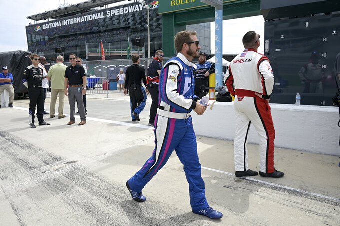 Driver JJ Yeley walks to his vehicle on pit road before a NASCAR Xfinity Series auto race at Daytona International Speedway, Saturday, Aug. 28, 2021, in Daytona Beach, Fla. (AP Photo/Phelan M. Ebenhack)