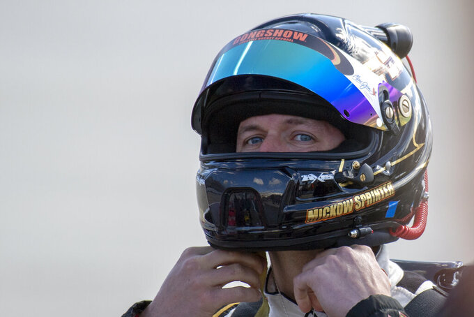 Driver Michael Annett secures his helmet before qualifying for the  NASCAR Xfinity Series auto race, Saturday, Oct. 5, 2019, in Dover, Del. (AP Photo/Brien Aho)
