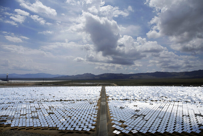 FILE - This Aug. 13, 2014, file photo, shows an array of mirrors at the Ivanpah Solar Electric Generating site in Primm, Nev. Some projects, including the approved $1 billion Gemini solar and battery storage project about 30 miles northeast of Las Vegas, have sparked debate about whether they are simply too big. (AP Photo/John Locher, File)