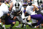 Michigan State running back Elijah Collins (24) runs for a touchdown against Northwestern during the first half of an NCAA college football game, Saturday, Sept. 21, 2019, in Evanston, Ill. (AP Photo/David Banks)