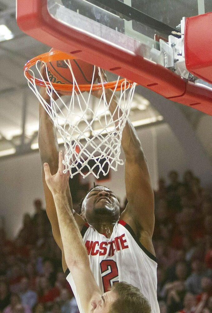 N.C. State's Torin Dorn dunks against Lipscomb during the first half of an NCAA college basketball game in the quarterfinals of the NIT on Wednesday, March 27, 2019, in Raleigh, N.C. (Travis Long/The News & Observer via AP)