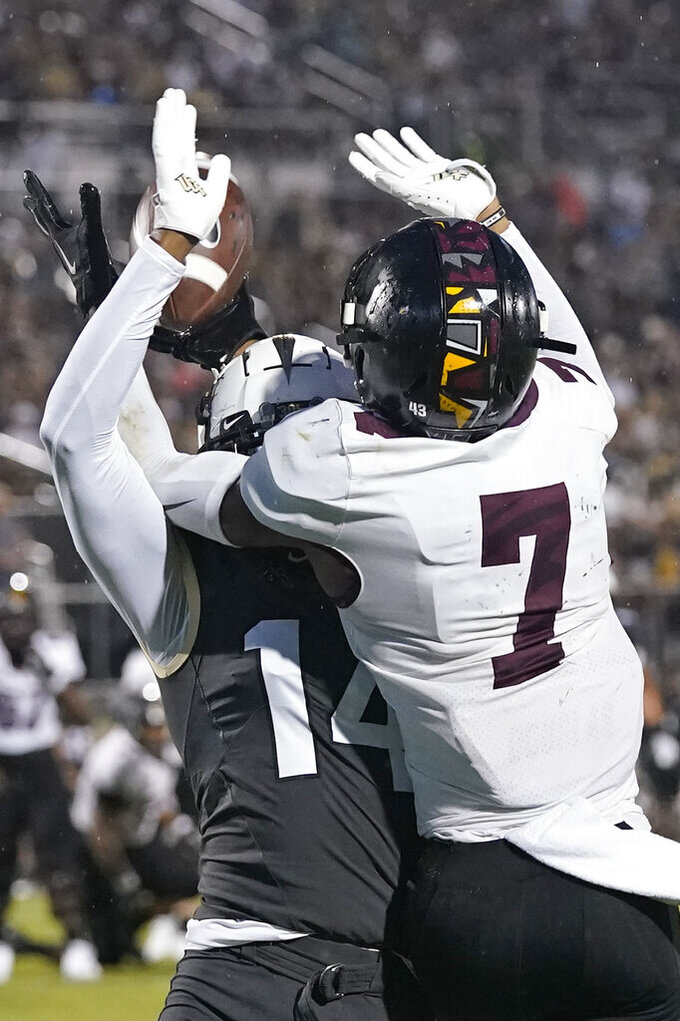 Bethune-Cookman wide receiver Darryl Powell Jr. (7) makes a touchdown catch despite defensive effort by Central Florida defensive back Corey Thornton, left, during the first half of an NCAA college football game, Saturday, Sept. 11, 2021, in Orlando, Fla. (AP Photo/John Raoux)