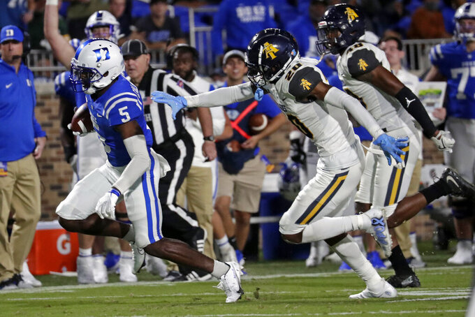 Duke wide receiver Jalon Calhoun (5) outruns North Carolina A&T defensive back Najee Reams (20) and linebacker Stephan Davis Jr. (48) for a long gain during the first half of an NCAA college football game in Durham, N.C., Friday, Sept. 10, 2021. (AP Photo/Chris Seward)