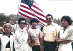 In this 1970s photo provided by Russell Contreras, Ciprian Contreras, second from right, with sunglasses in a yellow shirt, a World War II-era U.S. Marine, attends a July Fourth celebration with his family in Houston. In an essay, Associated Press writer Russell Contreras says the July Fourth holiday as a Mexican American has always troubled him because of his family's history in the U.S. But remembering his Uncle Ciprian Contreras' heroics as a U.S. Marine at Iwo Jima in 1945, makes him look at America's Independence Day differently. (Courtesy of Russell Contreras via AP)
