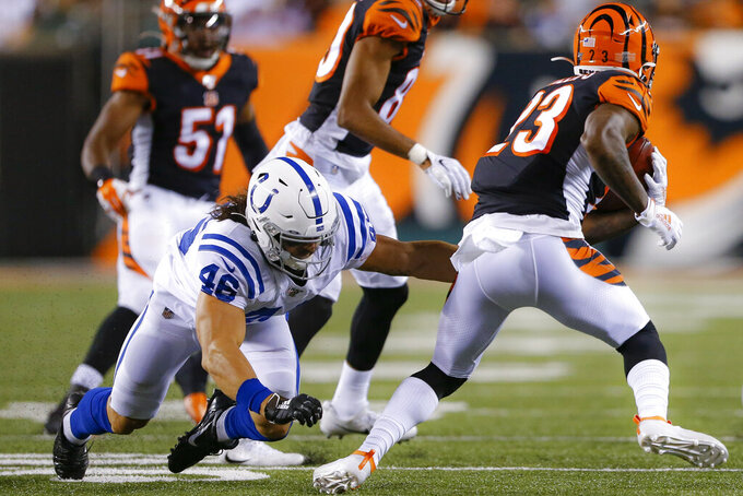 Cincinnati Bengals' Darius Phillips (23) breaks a tackle from Indianapolis Colts' Luke Rhodes (46) during the second half of an NFL preseason football game Thursday, Aug. 29, 2019, in Cincinnati. (AP Photo/Gary Landers)