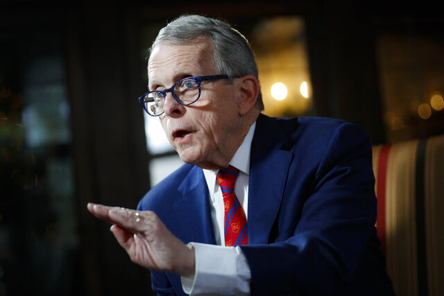 FILE - In this Dec. 13, 2019, file photo, Ohio Gov. Mike DeWine speaks during an interview at the Governor's Residence in Columbus, Ohio. The Ohio governor's positive, then false, results on COVID-19 tests threw fuel on the fire for skeptics about pandemic precautions and critics of the often-aggressive policies the governor championed. (AP Photo/John Minchillo, File)