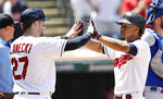 Cleveland Indians' Francisco Lindor, right, is congratulated by Kevin Plawecki after Lindor hit a two-run home run in the third inning of a baseball game, Sunday, July 21, 2019, in Cleveland. Plawecki scored on the play. (AP Photo/Tony Dejak)