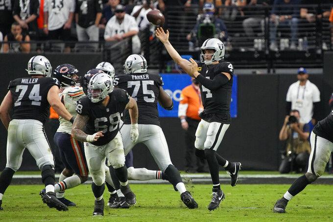 Las Vegas Raiders quarterback Derek Carr (4) throws against the Chicago Bears during the second half of an NFL football game, Sunday, Oct. 10, 2021, in Las Vegas. (AP Photo/Rick Scuteri)