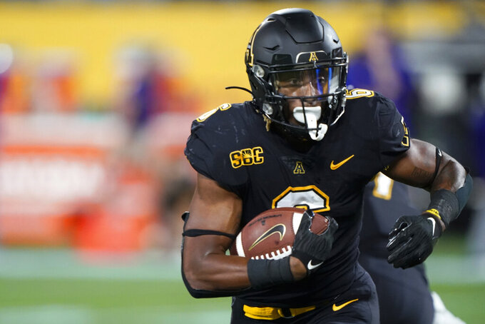 Appalachian State running back Camerun Peoples runs for a touchdown against East Carolina during the first half of an NCAA college football game Thursday, Sept. 2, 2021, in Charlotte, N.C. (AP Photo/Chris Carlson)