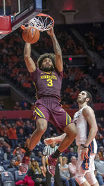 Minnesota forward Jordan Murphy (3) dunks over Illinois forward Giorgi Bezhanishvili during the second half of an NCAA college basketball game in Champaign, Ill., Wednesday, Jan. 16, 2019. Illinois won 95-68. (AP Photo/Rick Danzl)