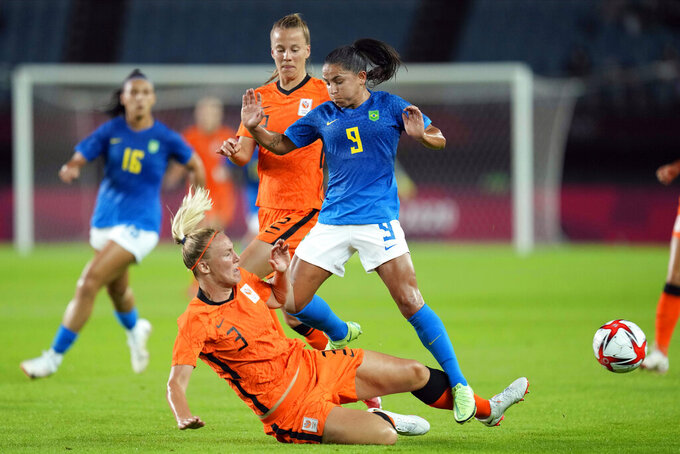 Netherlands' Stefanie van der Gragt (3) collides with Brazil's Debinha (9) during a women's soccer match at the 2020 Summer Olympics, Saturday, July 24, 2021, in Miyagi, Japan. (AP Photo/Andre Penner)