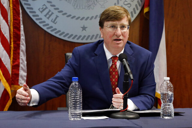 Gov. Tate Reeves speaks about selecting Burl Cain, the former warden of the Louisiana State Penitentiary, commonly known as Angola, as the new commissioner of the Mississippi Department of Correction, during Reeves' daily coronavirus update for media in Jackson, Miss., Wednesday, May 20, 2020. (AP Photo/Rogelio V. Solis)