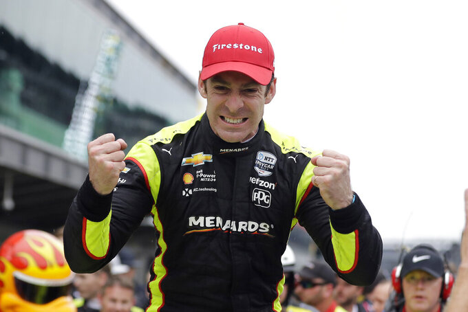 FILE - In this May 11, 2019, file photo, Simon Pagenaud, of France, celebrates after winning the Indy GP IndyCar auto race at Indianapolis Motor Speedway in Indianapolis. Pagenaud has won IndyCar's virtual race at Twin Ring Motegi in Japan. It is Pagenaud's second consecutive win in the virtual racing series and third for a Team Penske driver in the four races that have been staged since sports was shutdown during the coronavirus pandemic. (AP Photo/Darron Cummings, File)