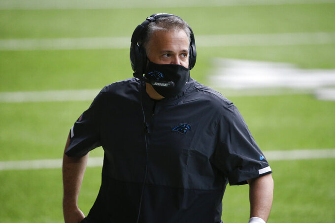 FILE - In this Nov. 29, 2020, file photo, Carolina Panthers head coach Matt Rhule watches from the sideline during the first half of an NFL football game against the Minnesota Vikings in Minneapolis. Rhule built a winner at Temple, then re-energized a Baylor program that was scandal-ridden. He came to a Panthers team in rebuilding mode, and while they're just 4-8, probably their two best players _ RB Christian McCaffrey and DL Kawann Short _ have been injured. (AP Photo/Bruce Kluckhohn, File)