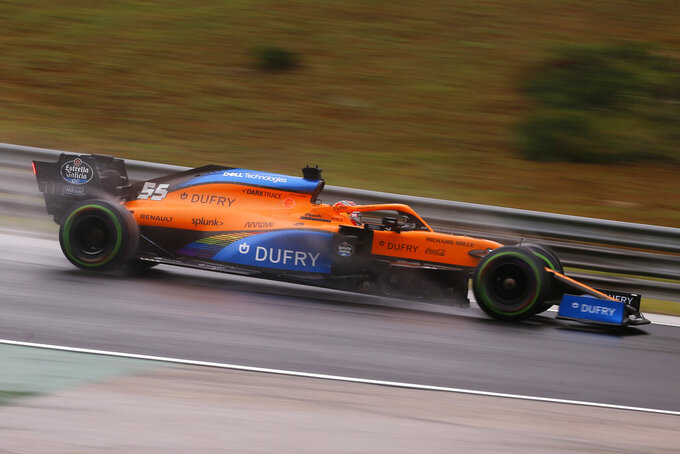 Mclaren driver Carlos Sainz of Spain steers his car during the second practice session for the Hungarian Formula One Grand Prix at the Hungaroring racetrack in Mogyorod, Hungary, Friday, July 17, 2020. The Hungarian F1 Grand Prix will be held on Sunday. (Darko Bandic/Pool via AP)