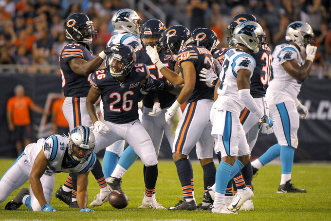 Chicago Bears defensive back Deon Bush (26) celebrates his interception of a pass from Carolina Panthers quarterback Will Grier during the first half of an NFL preseason football game Thursday, Aug. 8, 2019, in Chicago. (AP Photo/Mark Black)