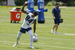 New England Patriots wide receiver Kendrick Bourne (84) mocks spiking the ball, but doesn't follow through, during NFL football practice in Foxborough, Mass., Thursday, May 27, 2021. (AP Photo/Steven Senne)