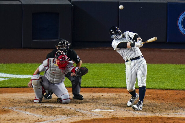 New York Yankees' Clint Frazier hits a three-run home run during the sixth inning of a baseball game against the Boston Red Sox Saturday, Aug. 15, 2020, in New York. (AP Photo/Frank Franklin II)