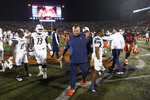 Illinois head coach Bret Bielema, center, walks off the field after his team's loss to UTSA in an NCAA college football game Saturday, Sept. 4, 2021, in Champaign, Ill. (AP Photo/Charles Rex Arbogast)