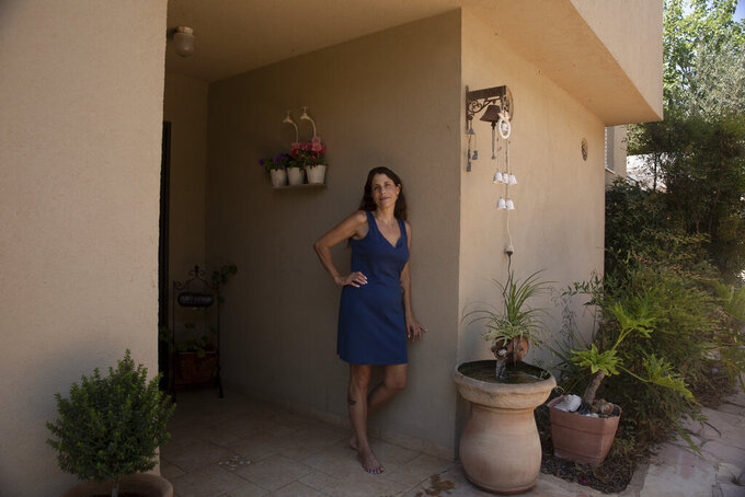 Idit Harel Segal, who donated a kidney to a Palestinian child from the Gaza Strip, poses for a portrait in her home in Eshhar, northern Israel, Tuesday, July 13, 2021. (AP Photo/Maya Alleruzzo)