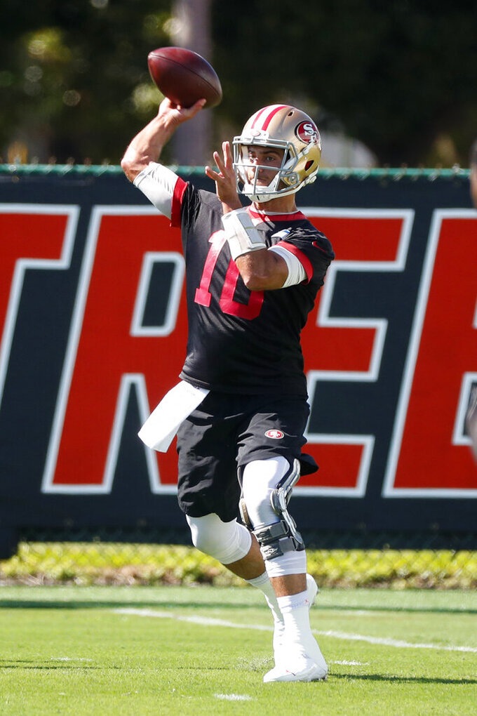 San Francisco 49ers quarterback Jimmy Garoppolo throws as he warms up during practice, Thursday, Jan. 30, 2020, in Coral Gables, Fla., for the NFL Super Bowl 54 football game. (AP Photo/Wilfredo Lee)