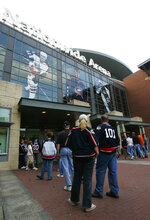 FILE - In this Sept. 22, 2005, file photo, hockey fans line up at the Nationwide Arena before the Columbus Blue Jackets host a preseason NHL hockey game against Detroit Red Wings in Columbus, Ohio. Nationwide Arena is one of the possible locations the NHL has zeroed in on to host playoff games if it can return amid the coronavirus pandemic. The league will ultimately decide on two or three locations for games, with government regulations, testing and COVID-19 frequency among the factors for the decision that should be coming within the next three to four weeks. (AP Photo/Kiichiro Sato, File)