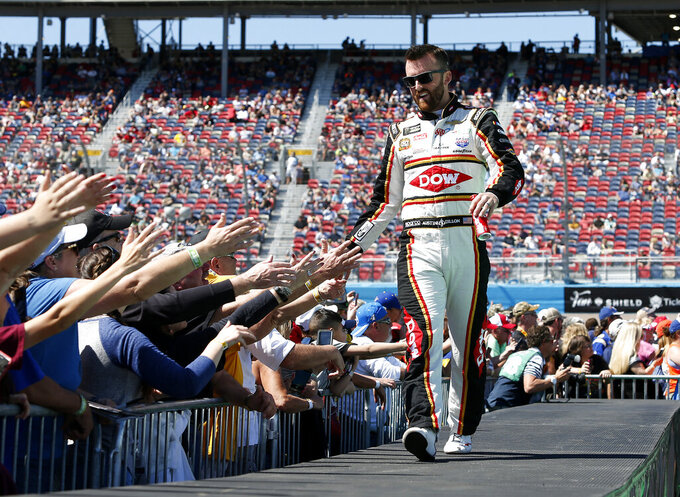 Austin Dillon is greeted by fans during driver introductions prior to the start of the NASCAR Cup Series auto race at ISM Raceway, Sunday, March 10, 2019, in Avondale, Ariz. (AP Photo/Ralph Freso)