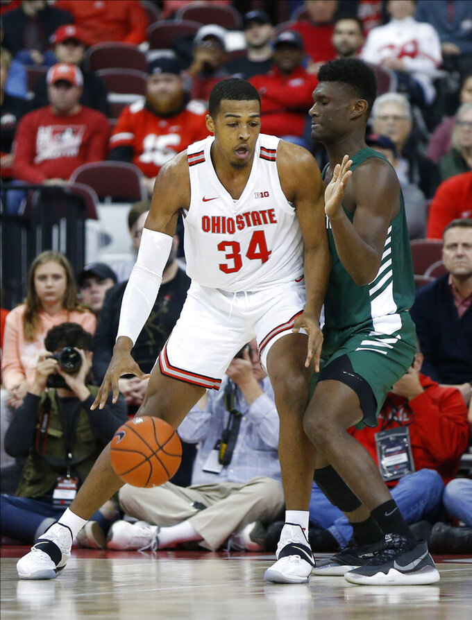 Ohio State's Kaleb Wesson, left, posts up against Stetson's Mahamadou Diawara during the first half of an NCAA college basketball game Monday, Nov. 18, 2019, in Columbus, Ohio. (AP Photo/Jay LaPrete)