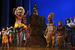 """""""The Lion King"""" cast appear at the curtain call following their first show back after the COVID-19 shutdown, at the Minskoff Theatre on Tuesday, Sept. 14, 2021, in New York. (Photo by Charles Sykes/Invision/AP)"""