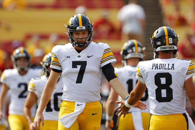 Iowa quarterback Spencer Petras (7) warms up before an NCAA college football game against Iowa State, Saturday, Sept. 11, 2021, in Ames, Iowa. (AP Photo/Matthew Putney)