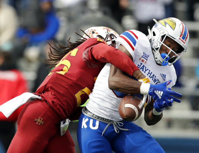 Iowa State defensive back Datrone Young, left, breaks up a pass intended for Kansas wide receiver Jeremiah Booker during the first half of an NCAA college football game in Lawrence, Kan., Saturday, Nov. 3, 2018. (AP Photo/Orlin Wagner)