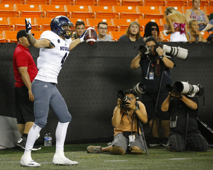 Nevada wide receiver Elijah Cooks (4) reacts after making a touchdown against Hawaii during the first half of an NCAA college football game Saturday, Oct. 20, 2018, in Honolulu. (AP Photo/Marco Garcia)