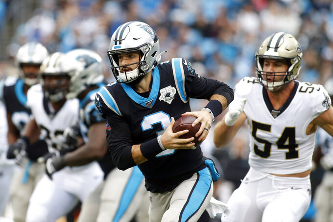 Carolina Panthers quarterback Will Grier (3) scxrambles against the New Orleans Saints during the first half of an NFL football game in Charlotte, N.C., Sunday, Dec. 29, 2019. (AP Photo/Brian Blanco)