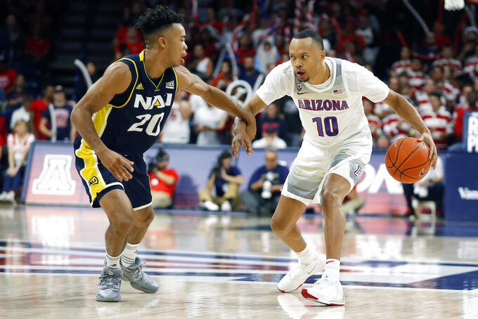 Arizona guard Jemarl Baker Jr. (10) is defended by Northern Arizona guard Cameron Shelton during the second half of an NCAA college basketball game Wednesday, Nov. 6, 2019, in Tucson, Ariz. (AP Photo/Rick Scuteri)