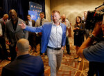 Los Angeles Rams head coach Sean McVay speaks to the media as he and Los Angeles Chargers head coach Anthony Lynn, left, view the new Los Angeles Stadium at Hollywood Park on a monitor during the annual NFL football owners meetings, Tuesday, March 26, 2019, in Phoenix. (AP Photo/Matt York)