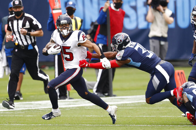 Houston Texans wide receiver Will Fuller (15) tries to get past Tennessee Titans free safety Kevin Byard (31) in the first half of an NFL football game Sunday, Oct. 18, 2020, in Nashville, Tenn. (AP Photo/Wade Payne)